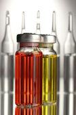 Medical ampules on grey background — Stock Photo