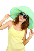 Smiling beautiful girl with beach hat and glasses isolated on white — Stock Photo