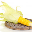 Stock Photo: Fresh corn cob on wicker mat isolated on white