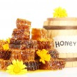 Sweet honeycombs, barrel with honey and flowers, isolated on white - Stock Photo