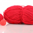 Red knittings yarns isolated on white - Stock Photo