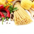 Pasta spaghetti, vegetables and spices, isolated on white — Stock Photo #13802252