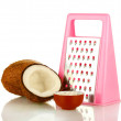 Coconuts wirh pink grater isolated on white — Stock Photo #13802257