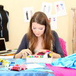 Beautiful young dressmaker in workroom — Stock Photo #13802304