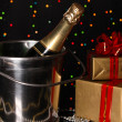 Celebratory champagne on Christmas lights background — Stock Photo #13802382
