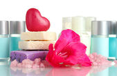 Cosmetic bottles, soap and flower, isolated on white — Stock Photo