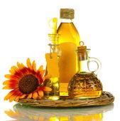 Olej w słoikach i słonecznik, na białym tle — Zdjęcie stockowe