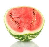 Połowa soczysty arbuz na białym tlesłodki melon na zielone tło zbliżenie — Zdjęcie stockowe