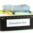 Donation box with clothing isolated on white — Stock Photo #13847019