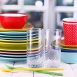 Colorful tableware on wooden table on window background — Foto Stock