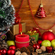 Composition from Christmas decorations on wooden table on wooden background - 