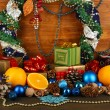 Composition from Christmas decorations on wooden table on wooden background — Stock Photo #13847615