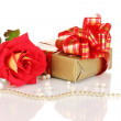 Beautiful red rose with wonderful gift in gold box isolated on white — Stock Photo