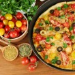 Colorful composition of delicious pizza, vegetables and spices on wooden ba - Stock Photo
