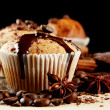 Tasty muffin cakes with chocolate, spices and coffee seeds, close up — Stock Photo #13847732