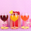 Colorful cocktails with bright decor for glasses on purple background with — Stock Photo