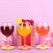 Stock Photo: Colorful cocktails with bright decor for glasses on purple background with