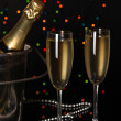 Celebratory champagne with stemware on Christmas lights background — Stock Photo #13847898