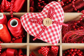 Red thread and material for handicrafts in box close-up — Stock Photo
