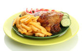 Roast chicken with french fries and cucumbers on plate, isolated on white — Stock Photo