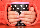 Hands holding mug of hot drink close-up — Stock Photo