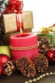 Composition from Christmas decorations close-up on wooden table on white ba — Stock Photo