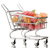 Shopping trolley with jelly candies, isolated on white — Stock Photo