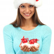 Beautiful young woman holding snow with christmas balls, isolated on white — Stock Photo #13853654