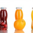 Delicious grapes, orange and apple juice in glass bottle — Stock Photo