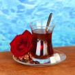 Stock Photo: Glass of Turkish tea on color background