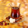 Stock Photo: Glass of Turkish teon color background