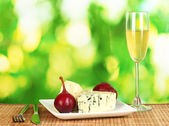 Composition of blue cheese and red pears — Stock Photo