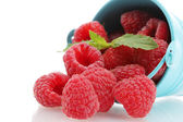 Beautiful raspberries in bucket isolated on white — Stock Photo