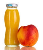 Delicious peach juice in glass bottle and peach — Stock Photo