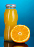 Delicious orange juice in a bottle and orange — Stock Photo