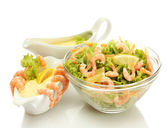 Salad with shrimps, lemon and lettuce leaves in bowl and sauce — Stock Photo