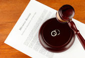 Divorce decree and wooden gavel on wooden background — Stock Photo