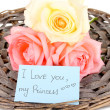 Stock Photo: Beautiful roses on wicker mat with card isolated on white