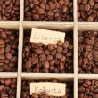 Coffee beans in wooden box close-up — Stock Photo #13870578
