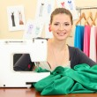 Beautiful young dressmaker in workroom — Stock Photo #13870642