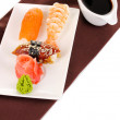 Delicious sushi served on plate isolated on white — Stock Photo