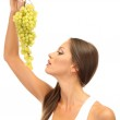 Beautiful young woman with grape, isolated on white — Stock Photo