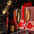 Celebratory champagne with stemware on Christmas lights background — Stock Photo