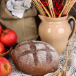 Rye bread on wooden table on autumn composition background - Stockfoto