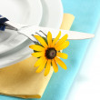 Stock Photo: Knife, fork and flower on plate, isolated on white