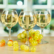 White wine in glass on window background - Stock Photo