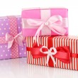 Colorful red, pink and purple gifts isolated on white — Stock Photo