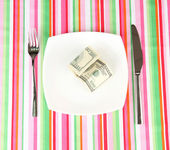 Banknotes on the plate on striped tablecloth close-up — Stock Photo