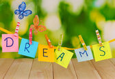 The word Dreams on wooden table on natural background — Foto Stock