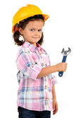 Beautiful little girl in helmet with wrench isolated on white — Stock Photo